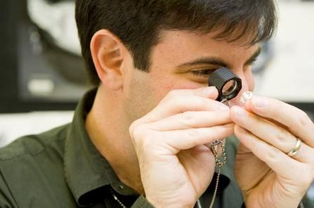 man evaluating jewelry