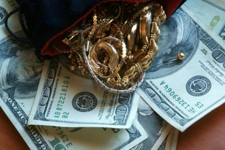 Jewelry and Hundred Dollar Bills